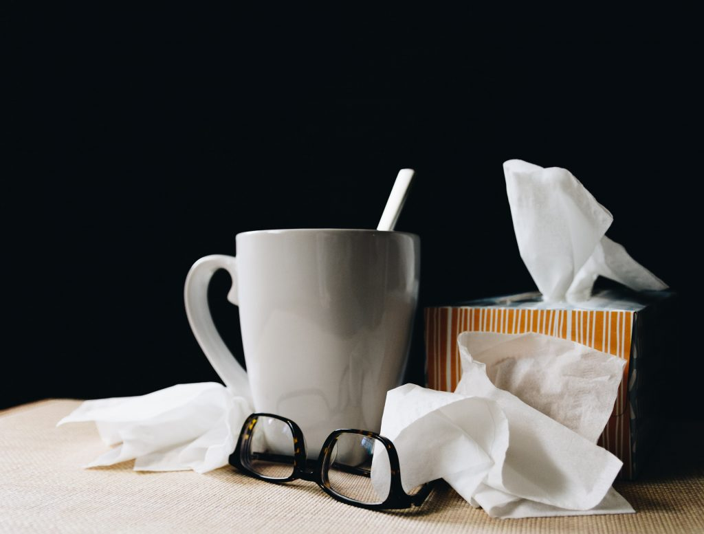 tissue box, mug and pair of glasses